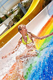 Child in bikini sliding water park. Happy child girl in bikini sliding water park Stock Photo
