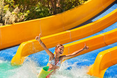 Child in bikini sliding water park Royalty Free Stock Photography