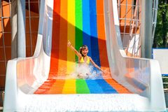 Child in bikini sliding water park Royalty Free Stock Images