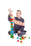 Child bilding a high tower Royalty Free Stock Images