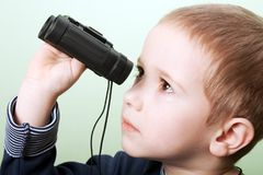 Child with binoculars Royalty Free Stock Images