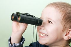 Child with binoculars stock image