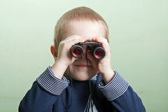 Child with binoculars Royalty Free Stock Photo