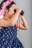 Child with Binoculars / Girl Using Binoculars Stock Image