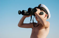 Child with binoculars outdoor Royalty Free Stock Photo