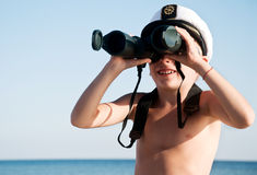 Child with binoculars outdoor Royalty Free Stock Images