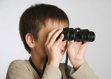 A child with binoculars Royalty Free Stock Images