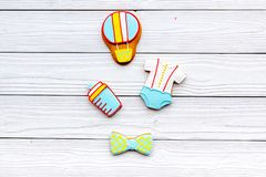Child birth. Accessories for newborn on white wooden baclground top view copy space. Child birth. Accessories for newborn on white wooden baclground top view Royalty Free Stock Images