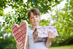 Child with birthday gift as a surprise. At birthday party Royalty Free Stock Image