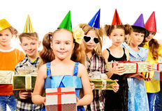 Child birthday. Happy kids having fun at a party. Holidays. Gifts. Isolated over white royalty free stock photo