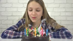 Child birthday party blowing candles, children anniversary, kids celebration stock video footage