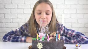 Child birthday party blowing candles, children anniversary, kids celebration.  stock video footage