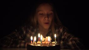 Child birthday party blowing candles in night, children anniversary celebration.  stock footage