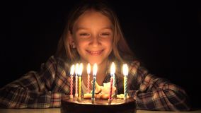 Child Birthday Party Blowing Candles in Night, Kid Celebrate with Cake in Dark.  stock video footage
