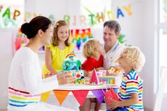 Child birthday party cake. Family with kids stock photos