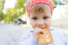 Child with Biscuit Stock Photo