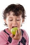 Child biting an apple Royalty Free Stock Photo