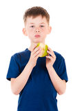 Child biting apple isolated on white Royalty Free Stock Images
