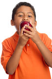 Child Biting on  Big Apple Royalty Free Stock Images