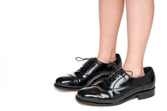 A child in black leather business shoes Stock Photo
