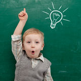 Child at the blackboard Royalty Free Stock Photography