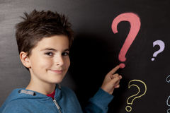 Child and blackboard. With question mark Stock Photo