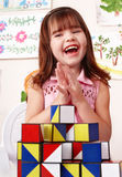 Child with block in play room. stock images