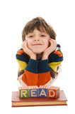 Child with block that spell READ Stock Images