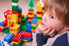 Child with blocks. Four years boy playing with colorful blocks Stock Photo