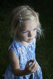 Child blond girl showing and studying little young snail Royalty Free Stock Images