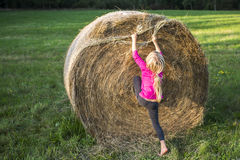 Child blond Girl by straw hay bale in field Stock Photos