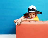 Child blonde girl with pink vintage suitcase ready for summer va. Cation. Travel and adventure concept Stock Photo