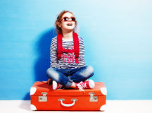 Child blonde girl with pink vintage suitcase ready for summer va. Cation. Travel and adventure concept Royalty Free Stock Photos