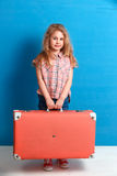 Child blonde girl with pink vintage suitcase ready for summer vacation. Travel and adventure concept Stock Photography