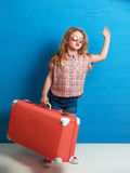Child blonde girl with pink vintage suitcase ready for summer vacation. Travel and adventure concept Stock Images