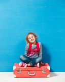 Child blonde girl with pink vintage suitcase ready for summer vacation. Travel and adventure concept.  royalty free stock images