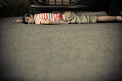Child with bloodied hip near front of car Stock Photography