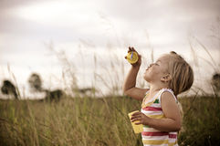 Child blowing bubbles Stock Images