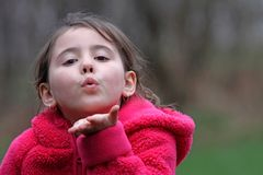 Child blowing kiss Stock Photo