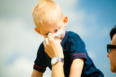 Child blowing nose. Boy with tissue. Catarrh or allergy Royalty Free Stock Image