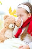 Child blowing nose Royalty Free Stock Photos