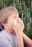 Child blowing nose with tissue paper at the park Royalty Free Stock Photo