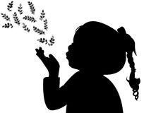 A child blowing out leaves. Silhouette vector Stock Photography