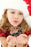 Child Blowing Snowflakes Stock Images