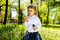 Child blowing soap bubbles. Royalty Free Stock Images