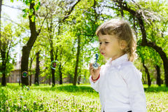 Child blowing soap bubbles. Royalty Free Stock Photos