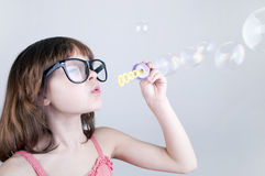 Child blowing soap bubbles Royalty Free Stock Images