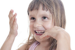 Child blowing soap bubbles Stock Photos