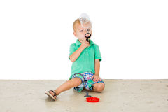 Child blowing soap bubbles in white background Royalty Free Stock Images