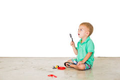 Child blowing soap bubbles in white background Stock Photos